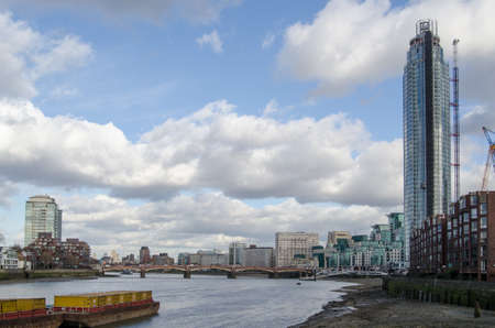 View along the south bank of the River Thames at the new St George s Wharf development in Nine Elms, Lambeth, London