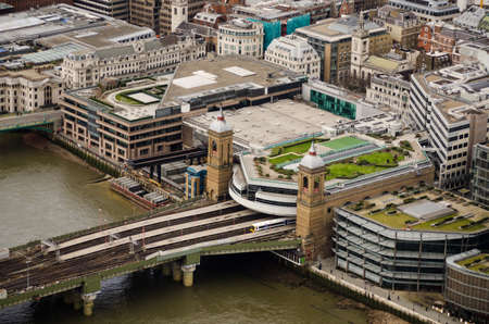 Bridge over the River Thames carrying railway tracks into Cannon Street Station, City of London   Aerial view from a tall building  photo