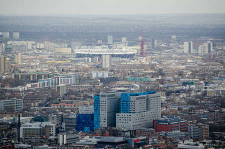 View from a tall building of the large Royal London Hospital in Whitechapel, East London with the athletic stadium in Stratford to the rear  Stock Photo