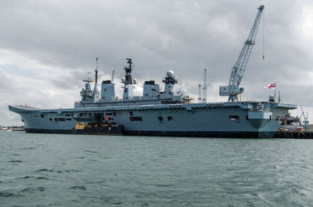 PORTSMOUTH, ENGLAND - AUGUST 2  Aircraft carrier HMS Illustrious docked in Portsmouth on August 2 2013   The Helicopter support ship is preparing to sail as part of a Royal Navy Taskforce to Gibraltar