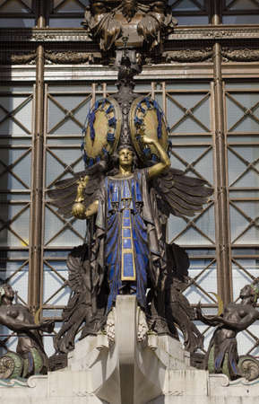 gilbert: The landmark Queen of Time statue on public display on the facade of Selfridges since 1931   The bronze was sculpted by Gilbert Bayes  1872 - 1953  and has gilded and faience elements