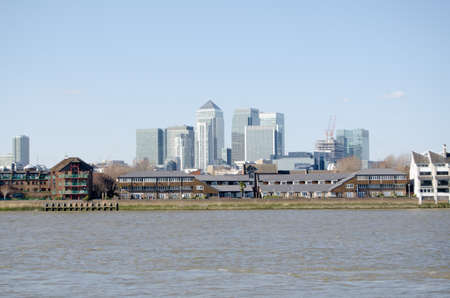 poplar  banks: View across the River Thames at Greenwich looking towards the Isle of Dogs and Canary Wharf   London