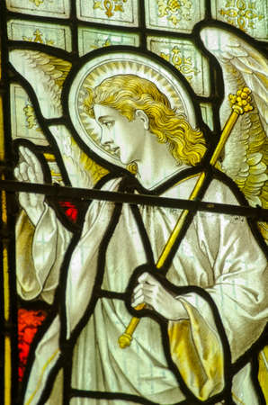 angel gabriel: Victorian stained glass window showing the Angel Gabriel at the Annunciation   Historic window on public display over 100 years