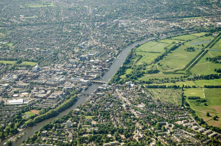 middlesex: Aerial view of the River Thames in South West London   Kingston-upon-Thames to the left and Hampton to the right of the river with Bushy Park and the grounds of Hampton Court   Editorial