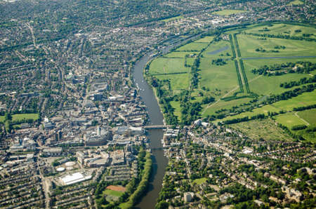 Aerial view of the River Thames with Kingston on the left hand side and Hampton Wick on the right with the grounds of Hampton Court Palace