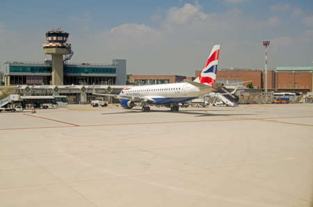 criticized: VENICE, ITALY - JUNE 11  A British Airways plane awaiting passengers at Marco Polo Airport, Venice on June 11 2013   The airline has been criticized for treating passengers poorly