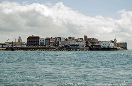 portsmouth: View from the sea of the historic Spice Island, also known as Portsmouth Point in Portsmouth, Hampshire   The site of breweries and pubs and formerly brothels frequented by sailors in the area