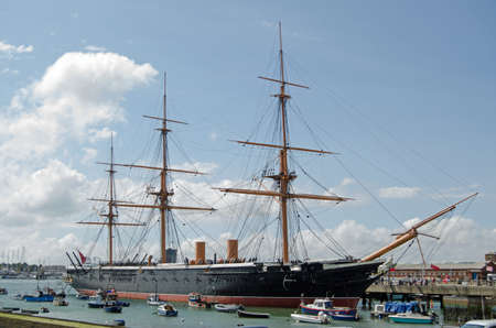HMS Warrior docked in Portsmouth, Hampshire   The first iron hulled armoured warship in the world and the fastest ship of her time   Now an historic attraction  Stock Photo