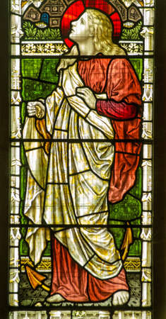 martyr: Victorian stained glass window showing Saint Clement with an anchor   The Christian martyr was thrown into the sea tied to an anchor    Historic window on public display over 100 years  Stock Photo