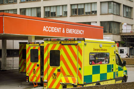 LONDON, ENGLAND - SEPTEMBER 21  Three ambulances parked outside the Accident and Emergency entrance of St Thomas  Hospital in central London on September 21, 2013   Pressure on the NHS is increasing this winter