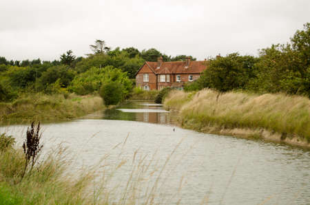 Historic house which was once the centre of the salt producing industry on the marsh at Keyhaven near Lymington, Hampshire   Now part of a nature reserve on the shore of the Solent