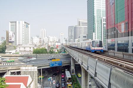 chit: BANGKOK, THAILAND - OCTOBER 26 2013  A Skytrain travelling on elevated track through central Bangkok just ahead of Phloen Chit station in Sukhumvit  Editorial