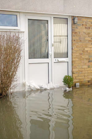 BASINGSTOKE, ENGLAND - FEBRUARY 16 2014  Flood waters reaching up to the front door of a house in Basingstoke, Hampshire after many days of heavy rain   Residents have been evacuated from the area