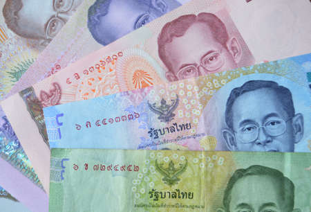 ix: A fan of banknotes from Thailand showing King Bhumibol Adulyadej  Rama IX both young and older    Used banknotes, photographed at an angle