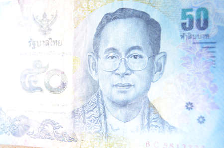 Thai banknote for 50 Baht with a portrait of King Bhumibol Adulyadej  Rama IX  nUsed banknote, photographed at an angle