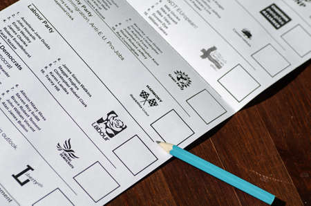 BASINGSTOKE, ENGLAND - MAY 14, 2014  Part of the long ballot paper for the European Parliamentary elections for the South East region of the UK   Fifteen parties are standing with voting on May 22, 2014