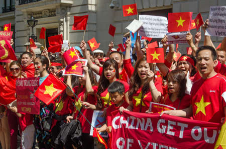 disputed: LONDON, ENGLAND - MAY 18, 2014   Vietnamese protesters demonstrating against China moving an oil rig into disputed waters