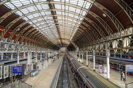 terminus: LONDON, UK - MAY 15, 2014   View of the London terminus for trains from the West of England and Wales - Paddington Station   Designed and built in Victorian times by Isambard Kingdom Brunel and still a very busy station