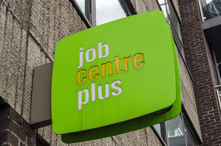 LONDON, UK - MAY 24, 2014   Sign outside a government-run Job Centre Plus on Lambeth   The Job Centre aims to encourage unemployed people to find work and cease claiming benefits  Editorial