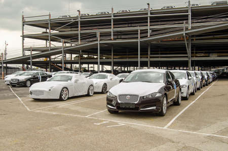 exported: SOUTHAMPTON, UK - MAY 31, 2014   Rows of newly-built Jaguar cars parked at Southampton docks before being exported