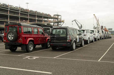 multi story car park: SOUTHAMPTON, UK - MAY 31, 2014   Rows of vehicles made by Land Rover in the UK queued at Southampton Docks awaiting export
