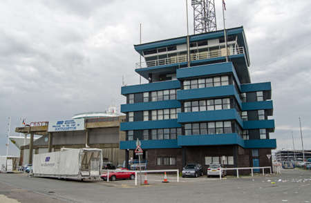 associated: SOUTHAMPTON, UK - MAY 31, 2014  Harbour Master and administrative offices at Southampton Docks, Hampshire   Run by Associated British Ports, the harbour has both freight and passenger terminals