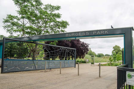 south london: LONDON, UK  JUNE 16, 2014   Camberwell entrance to Burgess Park in Southwark, South London   The urban green space stretches from Camberwell to Peckham and has a fishing lake, gardens and sporting facilities  Editorial