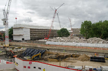 south london: LONDON, UK - JUNE 16, 2014   The Heygate Estate being demolished in Southwark, South London   The council housing was notorious for antisocial behaviour and crime  Editorial