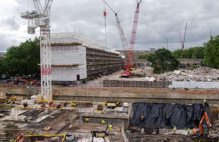 notorious: LONDON, UK  JUNE 16, 2014:  Construction work at the former Heygate Estate in Southwark, South London.  The council housing estate was notorious for crime and antisocial behaviour.