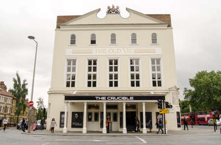 south london: LONDON, UK  JUNE 16, 2014   Facade of the historic Old Vic Theatre in Lambeth, South London   The theatre is showing a highly regarded production of The Crucible by Arthur Miller