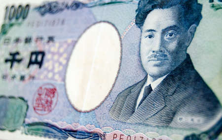 A one thousand Yen banknote from Japan photographed at an angle with the renowned bacteriologist Hideyo Noguchi on the front  Foto de archivo