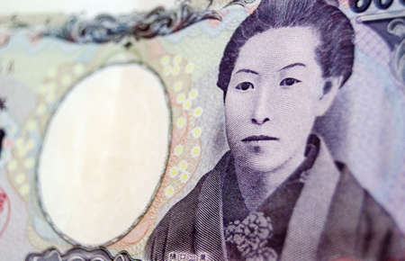The renowned Japanese author Ichiyo Higuchi, also known as Natsuko Higuchi, on the front of a 5000 Yen banknote   Used banknote, photographed at an angle  Foto de archivo