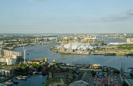 newham: View from a tall building of the River Thames bending around North Greenwich with the Millennium Dome in the centre