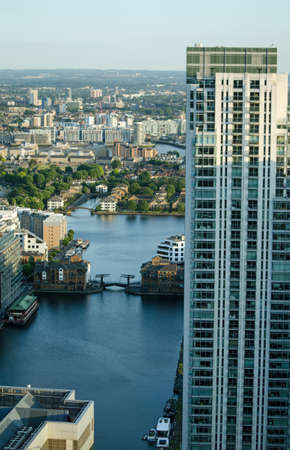 hamlets: View from a tall building of Millwall Inner Dock with the tall Pan Peninsula apartment block on the left hand side   London Docklands Stock Photo