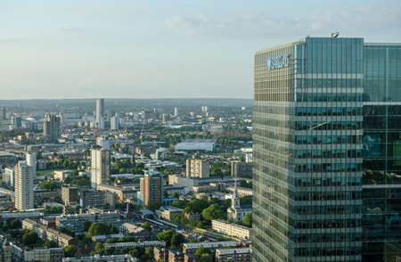 hamlets: View from a tall building in London Docklands of the flats and office blocks of Newham and Tower Hamlets   To the right is the skyscraper housing Barclays Bank Stock Photo