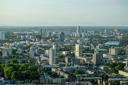 View from a tall building in the London Docklands looking towards Newham and Stratford with the former sports competition stadium towards the left hand side.