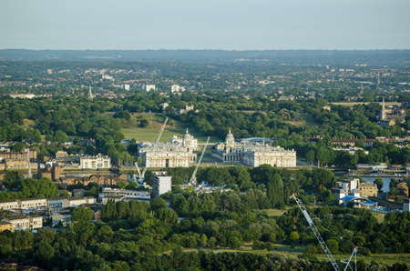 south london: View from a tall building in the London Docklands looking towards the Royal Naval College at Greenwich, South London.  Designed by Christopher Wren, with parkland behind leading to the Royal Observatory.