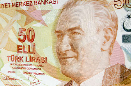 kemal: A used Turkish banknote for 50 Lira with the focus on the portrait of late President Mustafa Kemal Ataturk. Used banknote, photographed at an angle. Editorial