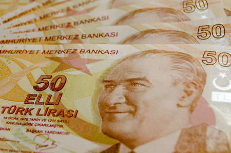 mustafa: Turkish fifty Lira banknotes laid out in a fan with the face of Mustafa Kemal Ataturk engraved.Used banknotes, photographed at an angle. Stock Photo