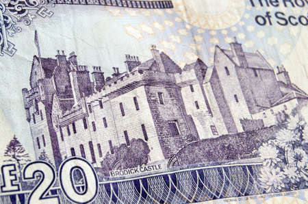 reproduced: The historic Brodick Castle on the Isle of Arran reproduced on a Royal Bank of Scotland banknote for twenty pounds sterling.  Used banknote, photographed at an angle.