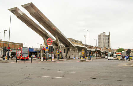 bus station: LONDON, UK - JULY 6, 2014: A cloudy morning at Vauxhall bus station, a landmark in the London Transport network.