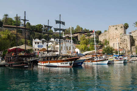 ANTALYA, TURKEY - AUGUST 18, 2014: Pleasure boats moored in the historic old harbour of Antalya, Turkey.