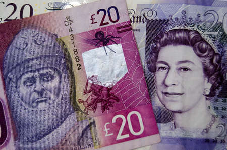 Banknotes for 16320 issued by the Clydesdale Bank and the Bank of England.  One shows King Robert I of Scotland, known as Robert the Bruce the other has Queen Elizabeth II.  There39s concern that Scotland might not keep the pound sterling currency if ther Stock Photo
