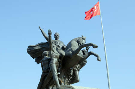 fortitude: Monument to the National Rising featuring Kemal Ataturk in Republic Square, Antalya, Turkey.  Sculpted in 1964 by Huseyin Gezer to commemorate National Liberation day of May 19, 1919 and on public display with flags since.