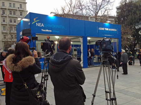 political party: ATHENS, GREECE - JANUARY 25, 2015:  Journalists and television crews waiting beside the stand of the defeated New Democracy political party the day after they were ousted from power in the Greek elections.  Syntagma Square, Athens. Editorial