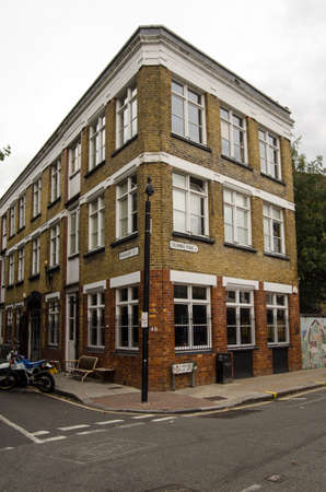 brawn: LONDON, UNITED KINGDOM - AUGUST 30, 2014:  The trendy restaurant Brawn on the Columbia Road in Haggerston.  Close to the hip areas of Hoxton and Shoreditch, the restaurant is popular with young locals and visitors.