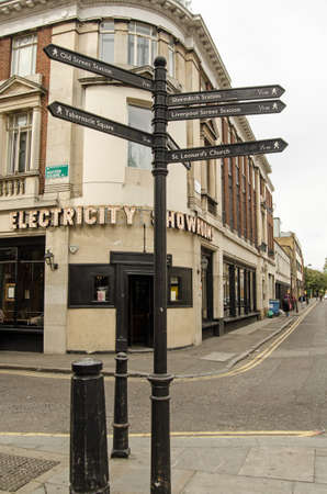 east end: LONDON, UNITED KINGDOM - AUGUST 30, 2014:  Finger signpost to useful places in the centre of Hoxton, a fashionable district in London.