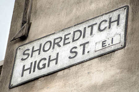 east end: Road sign for Shoreditch High Street, a fashionable street full of cafes and shops popular with hipsters in the Hackney district of London.