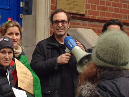 consulate: LONDON, UK - FEBRUARY 28, 2015: One of the speakers, holding a megaphone, at a demonstration by Portuguese migrants outside their nations consulate in Portland Place, London.  Theyre complaining that staffing levels at the consulate havent increased Editorial