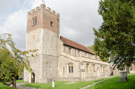 typically english: The historic parish church of St John the Baptist in the Hampshire market town of Alresford. Editorial